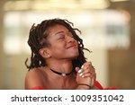 glad black female keeping eyes... | Shutterstock . vector #1009351042