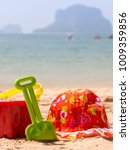 bucket and spade by the ocean... | Shutterstock . vector #1009359856