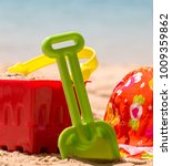 bucket and spade by the ocean   ... | Shutterstock . vector #1009359862