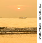 sunset in thailand with sea and ... | Shutterstock . vector #1009360162