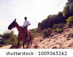 young man horseback riding | Shutterstock . vector #1009365262