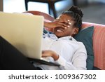 young african woman lying on... | Shutterstock . vector #1009367302