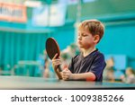 the boy with the racket for... | Shutterstock . vector #1009385266