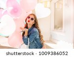 charming long haired girl in... | Shutterstock . vector #1009386052