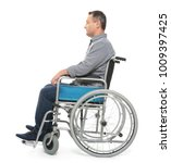 mature man in wheelchair on... | Shutterstock . vector #1009397425