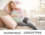 young woman with soft pillow at ... | Shutterstock . vector #1009397998