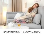 sick woman wrapped in warm... | Shutterstock . vector #1009425592
