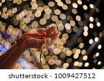empty hands holding lanterns... | Shutterstock . vector #1009427512
