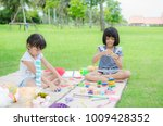 asian child happy play in park | Shutterstock . vector #1009428352