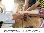 students teamwork stacking hand ... | Shutterstock . vector #1009429942