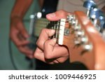 human hand is playing guitar. | Shutterstock . vector #1009446925