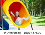 kids climbing and sliding on... | Shutterstock . vector #1009457602
