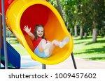 kids climbing and sliding on... | Shutterstock . vector #1009457602