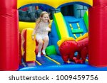 child jumping on colorful... | Shutterstock . vector #1009459756