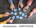 group of people with puzzle... | Shutterstock . vector #1009470328