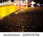 wet car roof in evening street... | Shutterstock . vector #1009470796
