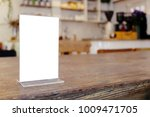 mock up menu frame standing on... | Shutterstock . vector #1009471705