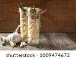 preserved garlic in glass jars... | Shutterstock . vector #1009474672