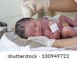 new born baby in doctor's hands | Shutterstock . vector #100949722