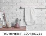 clean towel on rack in bathroom | Shutterstock . vector #1009501216