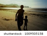 Silhouette Style Of Mother And...