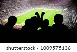 silhouettes of fans celebrating ... | Shutterstock . vector #1009575136