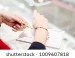 woman owner of jewelry shop... | Shutterstock . vector #1009607818