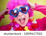 little smiling girl with pink... | Shutterstock . vector #1009617502