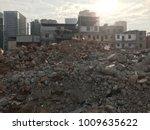 demolish building with debris... | Shutterstock . vector #1009635622