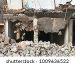 demolish building with debris... | Shutterstock . vector #1009636522