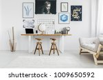 wooden stools at desk with... | Shutterstock . vector #1009650592
