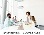 business people around table... | Shutterstock . vector #1009657156