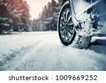 Car Tires On Winter Road...