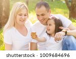 happy family of three having... | Shutterstock . vector #1009684696