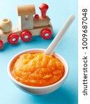 pumpkin and carrot baby puree... | Shutterstock . vector #1009687048