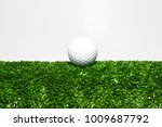 White Golf Balls Placed On A...