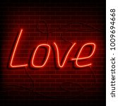 neon word love. a bright red... | Shutterstock .eps vector #1009694668