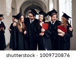 a group of students in mantles... | Shutterstock . vector #1009720876