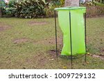 a green garbage bag under the... | Shutterstock . vector #1009729132