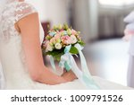 colorful bouquet in hands of... | Shutterstock . vector #1009791526