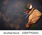 Cutting Board With Herbs And...