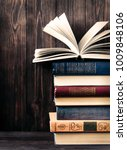 old books on wooden background. ... | Shutterstock . vector #1009848106