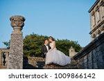 romantic wedding couple sitting ...   Shutterstock . vector #1009866142
