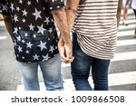 gay couple having a great time... | Shutterstock . vector #1009866508