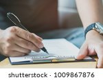 close up hands of person... | Shutterstock . vector #1009867876