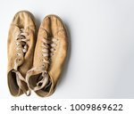 old dirty and shabby old shoes... | Shutterstock . vector #1009869622