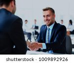 businessman shaking hands to