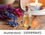 a bottle of lavender essential... | Shutterstock . vector #1009898692