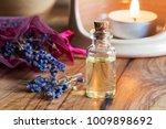 a bottle of lavender essential... | Shutterstock . vector #1009898692