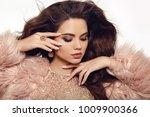 fashion portrait of beautiful... | Shutterstock . vector #1009900366